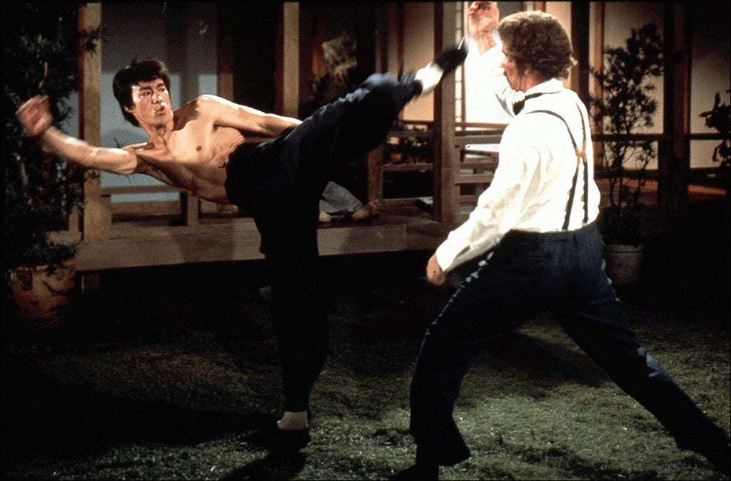 Bruce Lee kicking the villain in the 1972 movie Fist of Fury