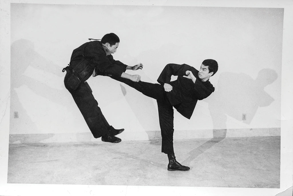 Bruce Lee kicking Jeet Kune Do student Ted Wong
