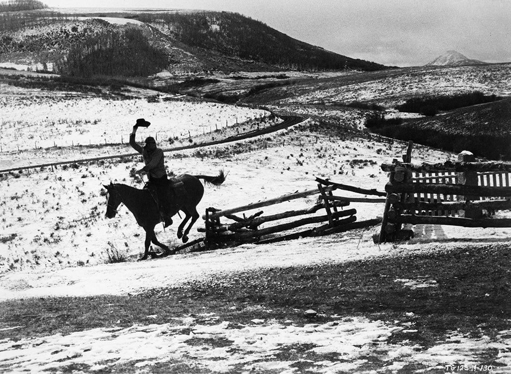 John Wayne True Grit closing scene riding horse and waving hat in air