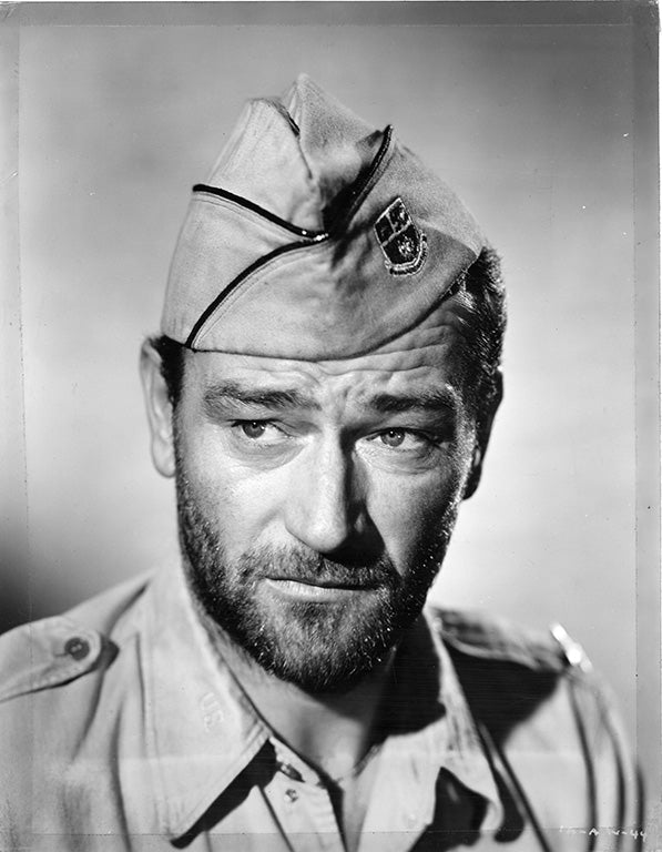 John Wayne in military uniform for Back to Bataan movie
