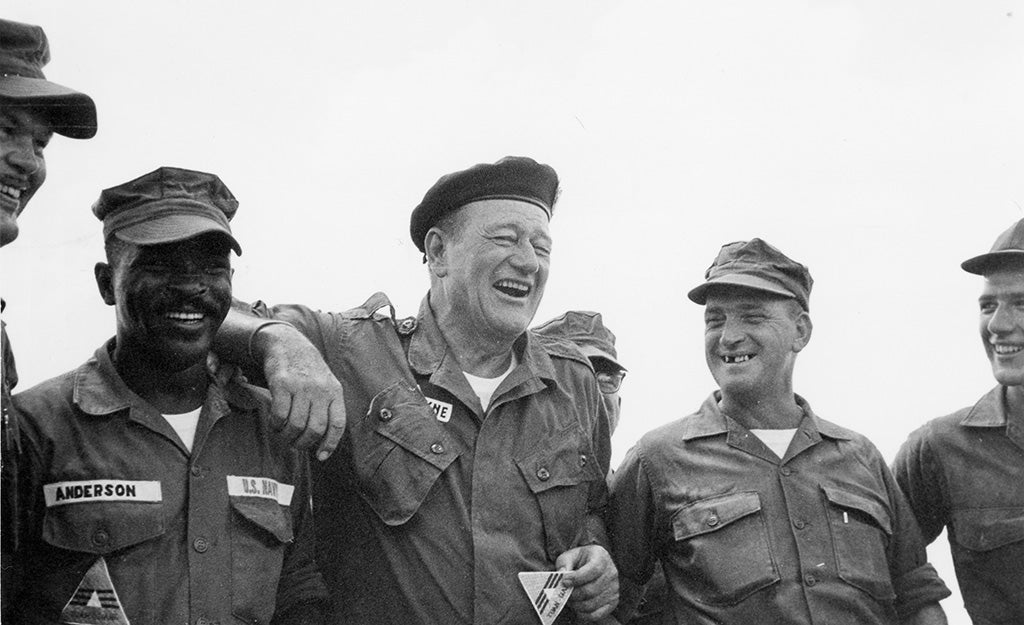 John Wayne laughing with troops in Vietnam