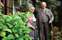 Inside magazine spread of Newsweek Special Edition featuring image of J.R.R. Tolkien and wife posing in garden