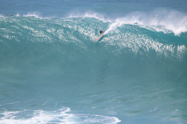 Ricardo dropping in on a bomb at Waimea Bay