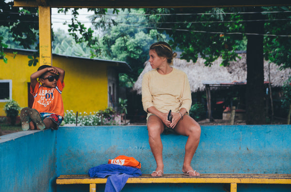 Surf instructor Katie getting chatted up by a local.  Photo by Alice Ward.