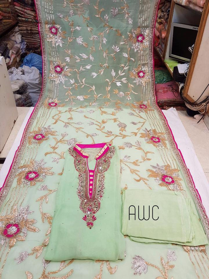 Pure Georget Designer Salwar with kundan handwork and jarkan work , thread work on neck. Pure Shiffon Dupatta with Beautifull Golden Gota work and thread work