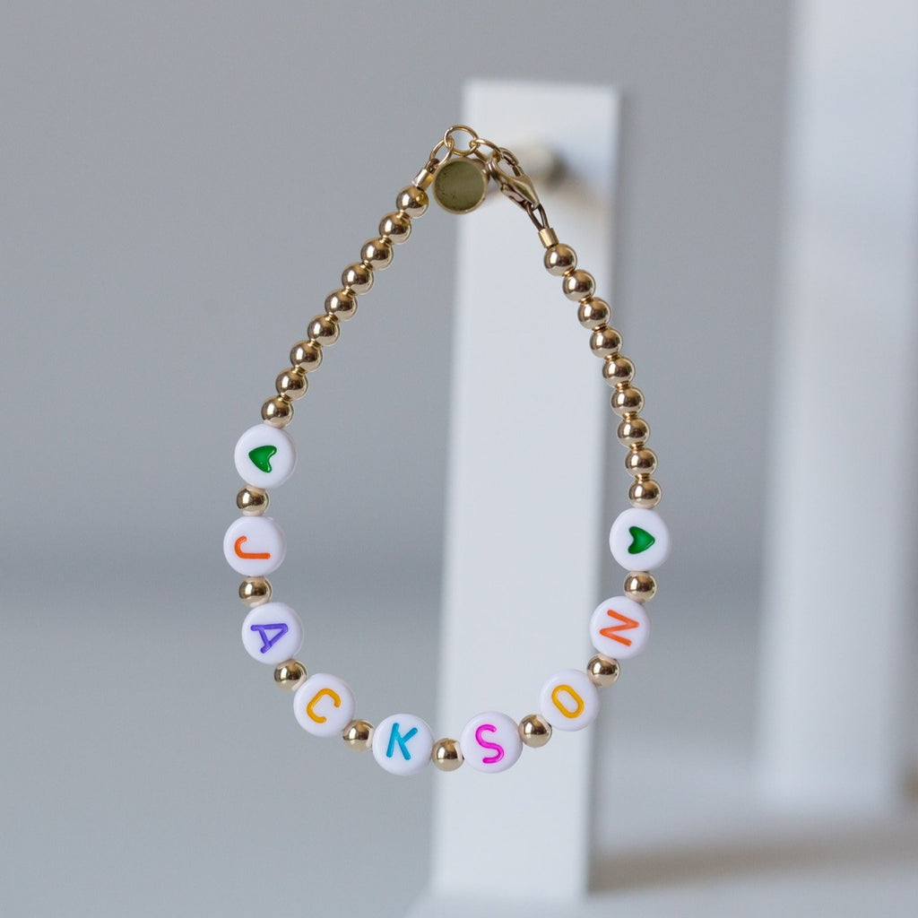 Pastel letters on white beads WITH metallics between