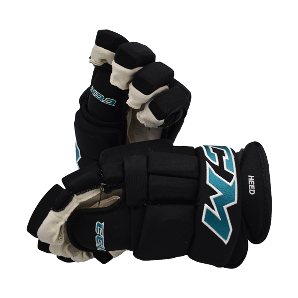 Used Tim Heed CCM Gloves