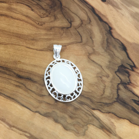 Aztec oval sterling silver pendant