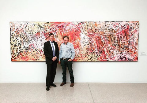 "Don Holt with Kelvin Templeton in front of Emily Kngwarreye's ""Yam Awelye"", donated to the National Gallery of Victoria by the Holt Family."