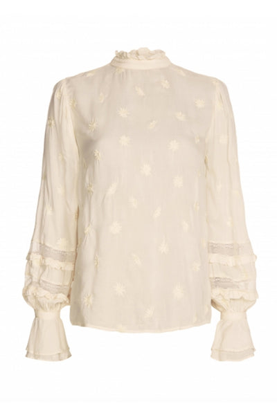 Leo top from fabienne chapot, ruffled front with sun embroidery