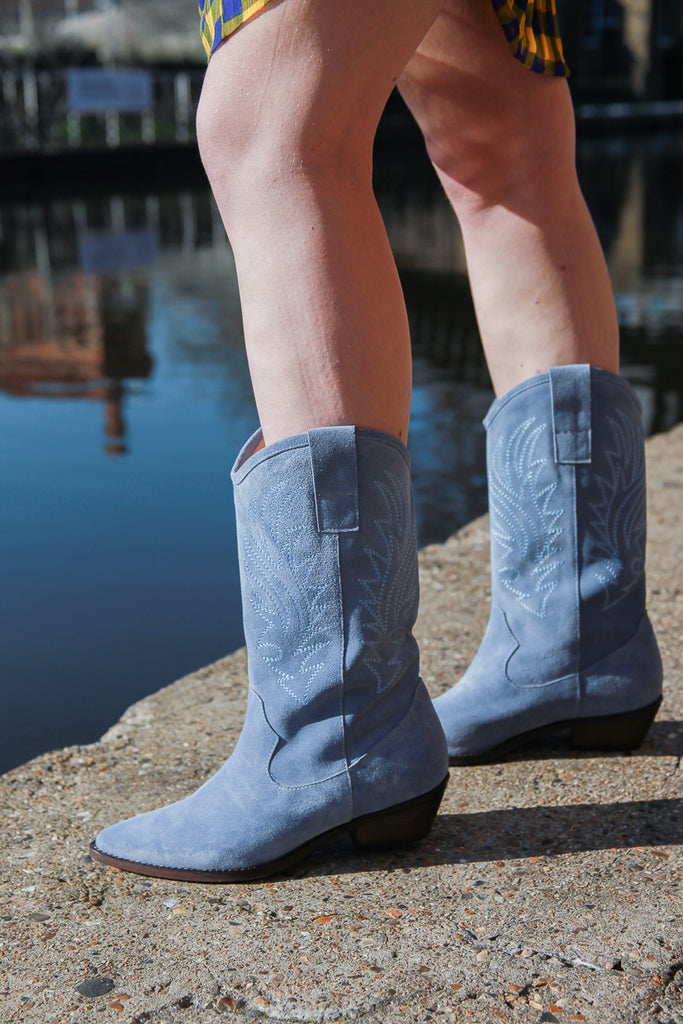 donna light blue cowboy boots by Portamento