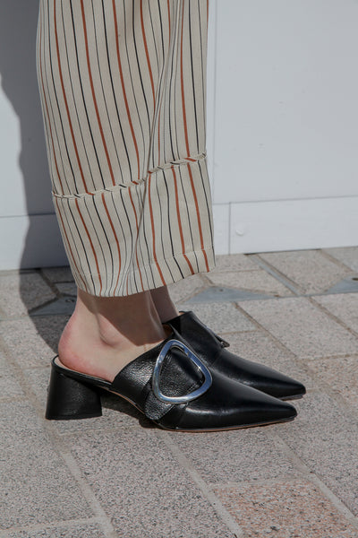 High shine black calf leather mules by Portamento