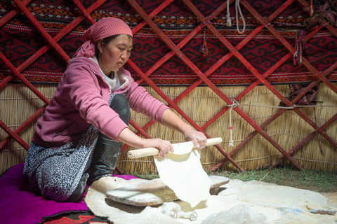 Uuzbu making bread in a yurt