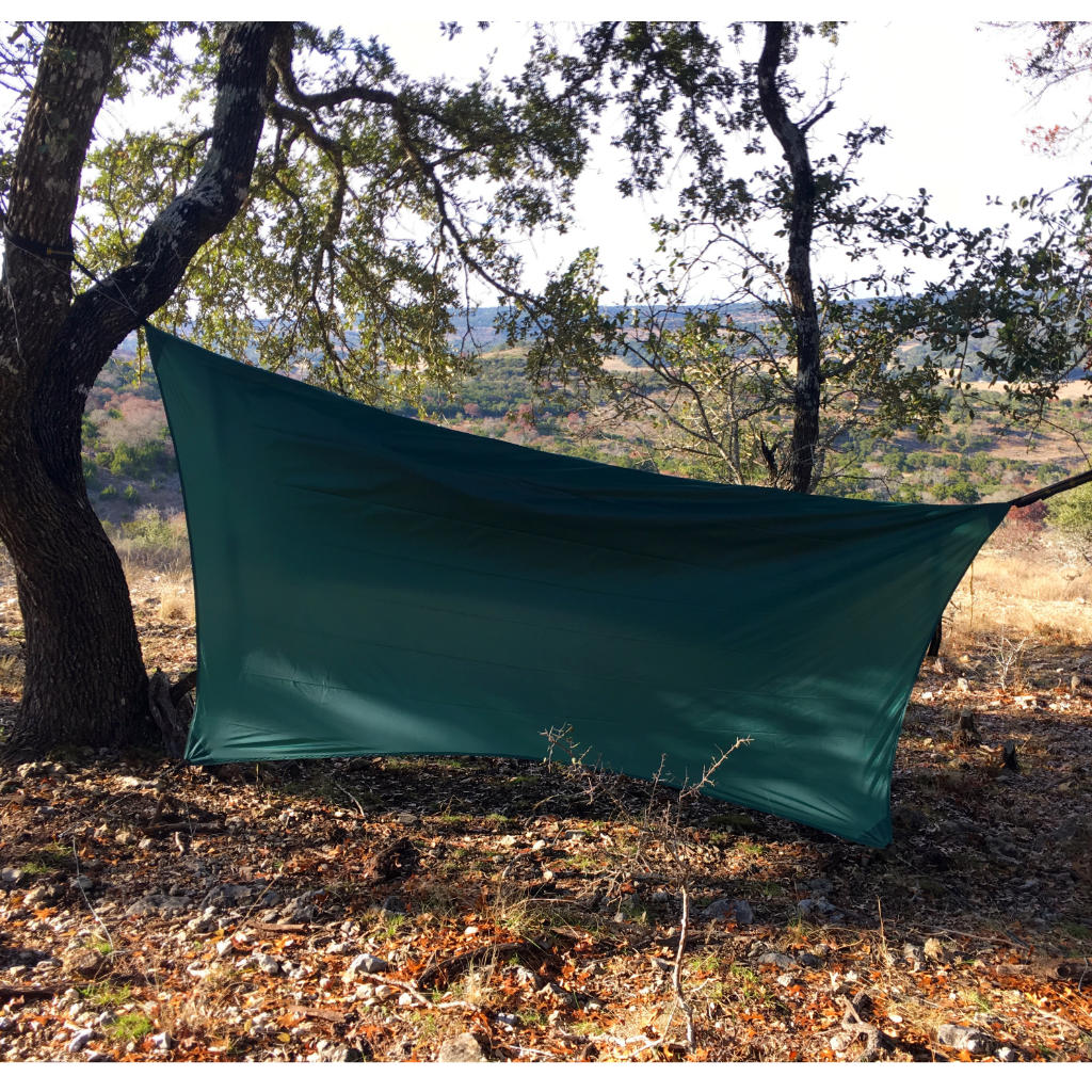 This hex-cut hammock tarp is hung much lower to the ground in an attempt to provide additional protection for a cold and windy night of hammock camping