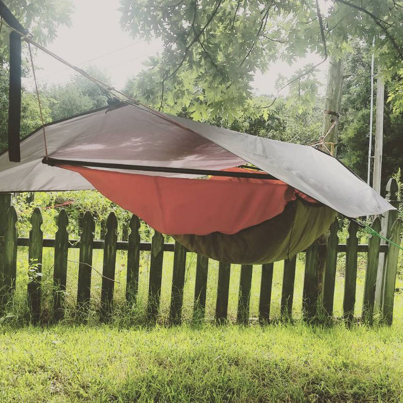 Bridge hammocks like this one have a more trough-like shape. Bridge hammock shown with a hexagonal tarp hung over it