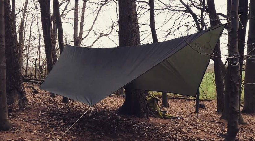 This hexagonal hammock tarp is also called a catenary-cut tarp. It provides moderate coverage and is a good three-season option with limited winter usability