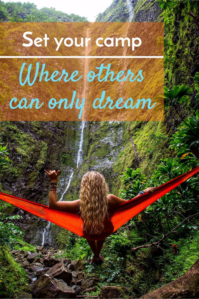 "Image of a girl hammock camping by a waterfall with overlay text ""Set your camp where others can only dream"""