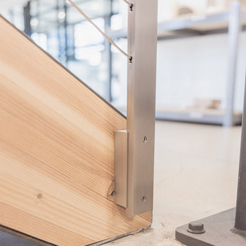 install bracket first on stairs and then attach post