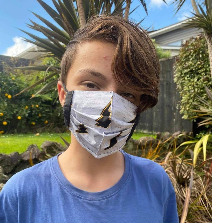 Lightening bolt face mask on child