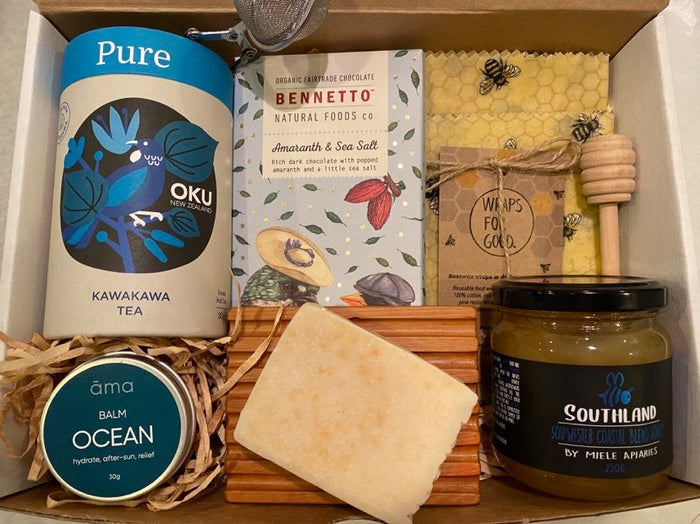 Pure Gift Box With Tea from OKU, Chocolate from Bennetto, Ocean Balm, Sopa and Sopa dish by ama, Beeswax wraps by Wraps for Good, Honey by Miele Apiaries