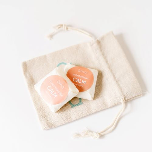 Calm Solid Shampoo and Conditioner samples in a linen bag