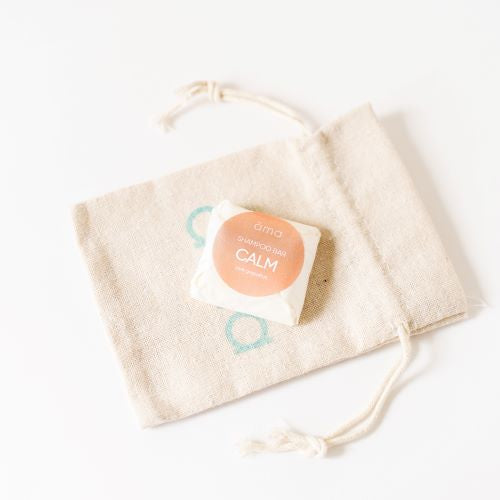 Calm solid shampoo sample in a linen bag