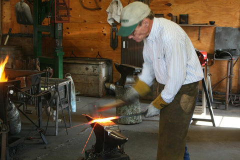 Artist Blacksmith Walter Howell strikes hot iron and creates heirloom quality iron work