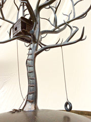 Hand forged iron treehouse and tire swing