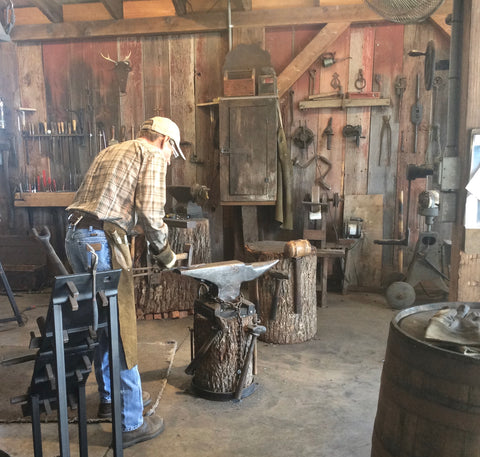 Walter Howell working at his anvil. The process is very labor intensive