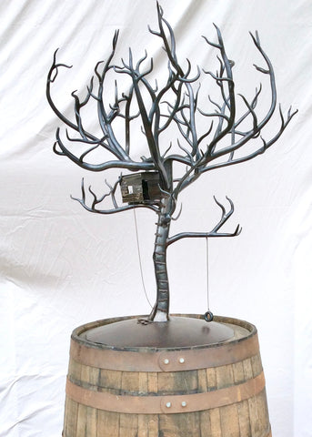 Forged Steel sculpture of a full size tree with tree house and swing.