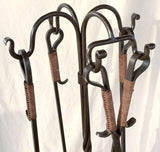 Forged fishtail hooks serve as hangers for the 4 fire tools