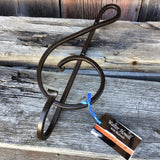 Forged iron treble clef wall hook 15 inches long. Strong decorative brown hardware.