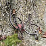 Our forged treble clefs are available as wall art or as a strong wall hook in brown or deep red finish