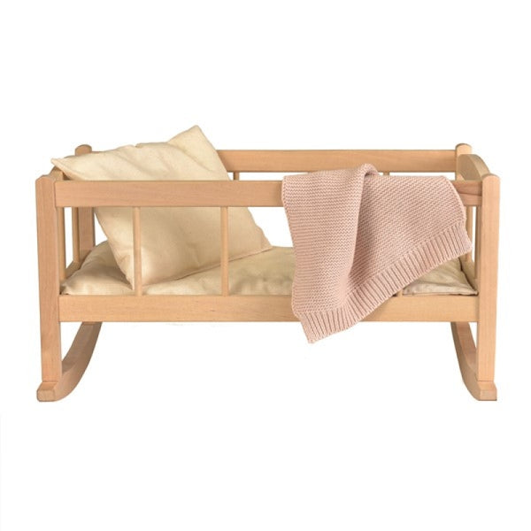 wooden rocking cradle with knitted blanket