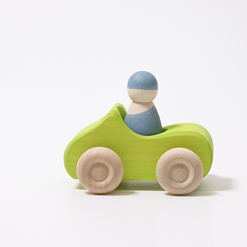small green car with 1 figure