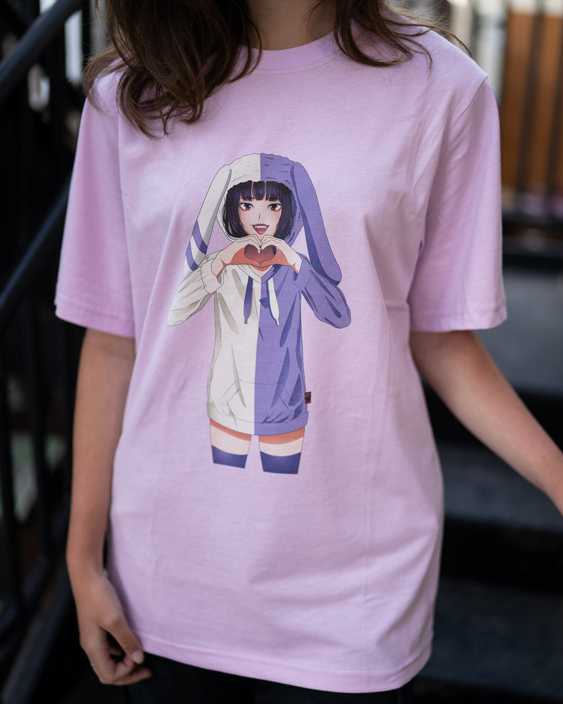 bunny girl wearing a split purple and cream hoodie printed on a lavender pink shirt