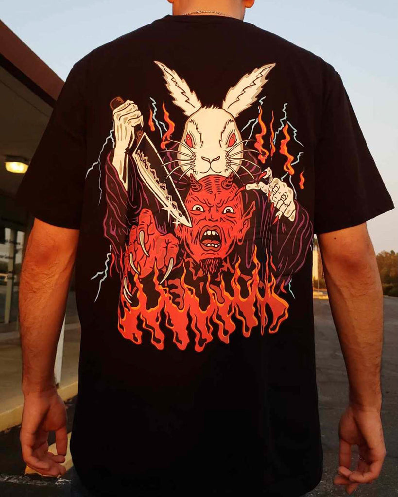 rabbit holding a knife ready to stab a demon screen printed on the back of a black shirt