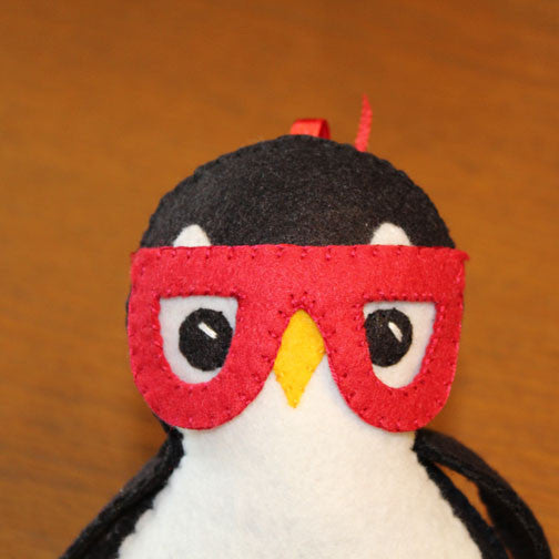 removable felt red glasses on felt penguin plush