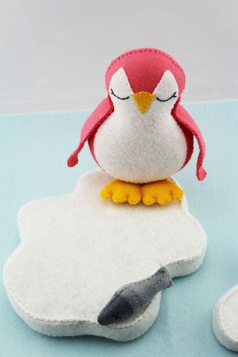 Pink Penguin on Ice with Fish