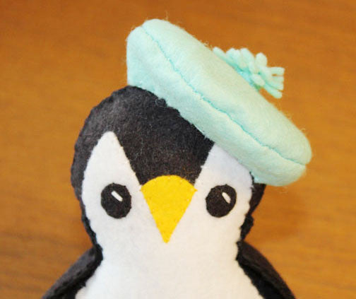 plush felt penguin wearing felt beret