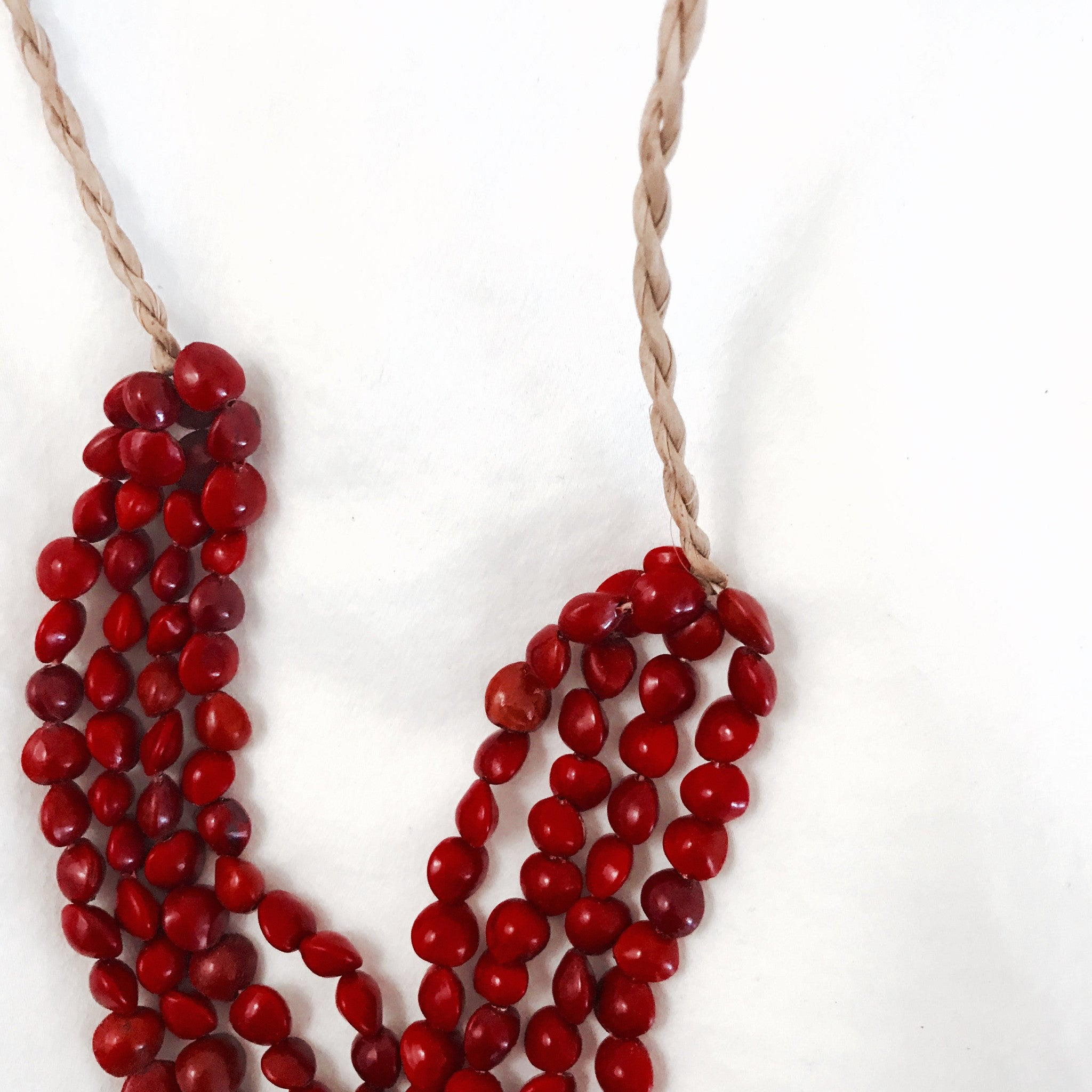 red seed necklace