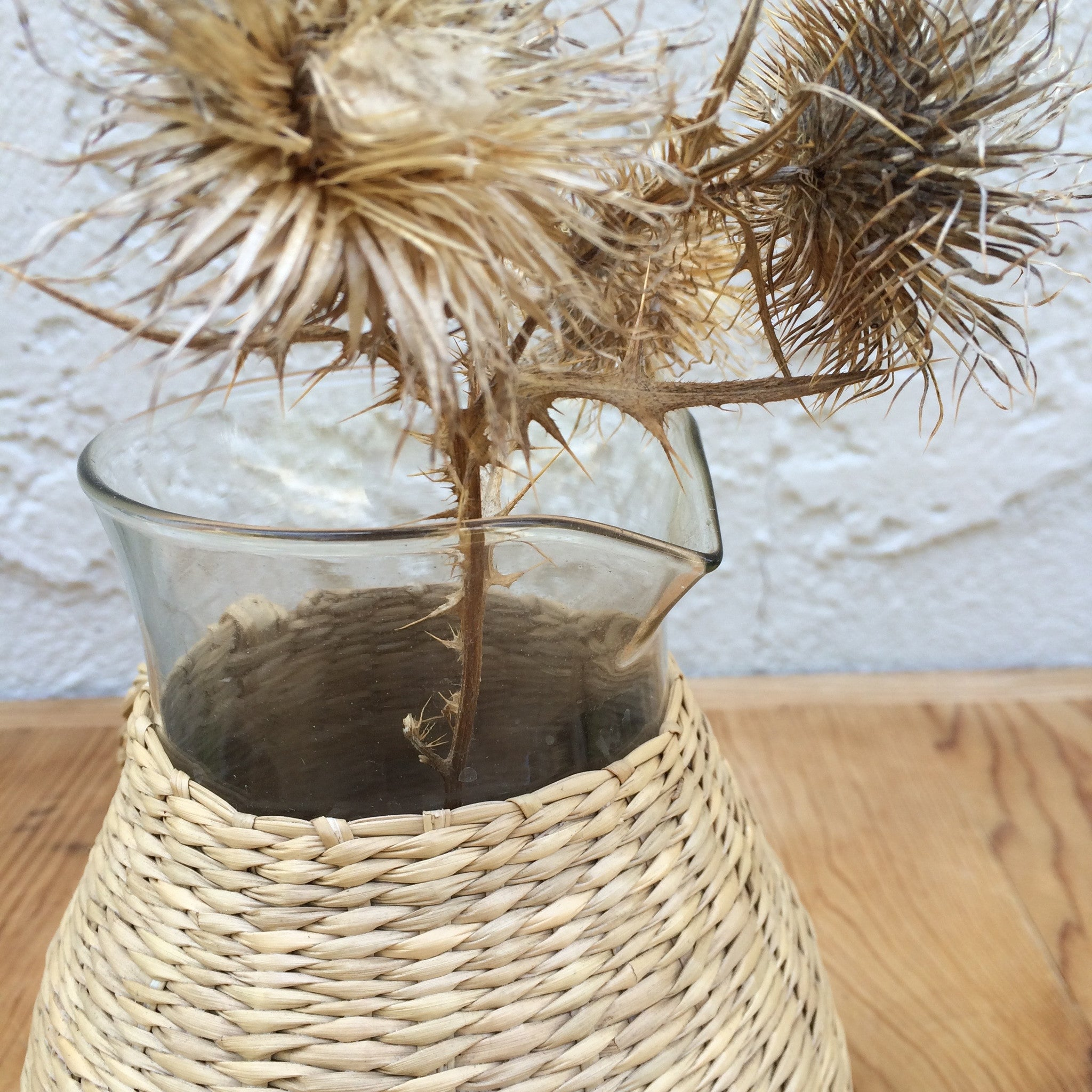 wicker and glass pitcher