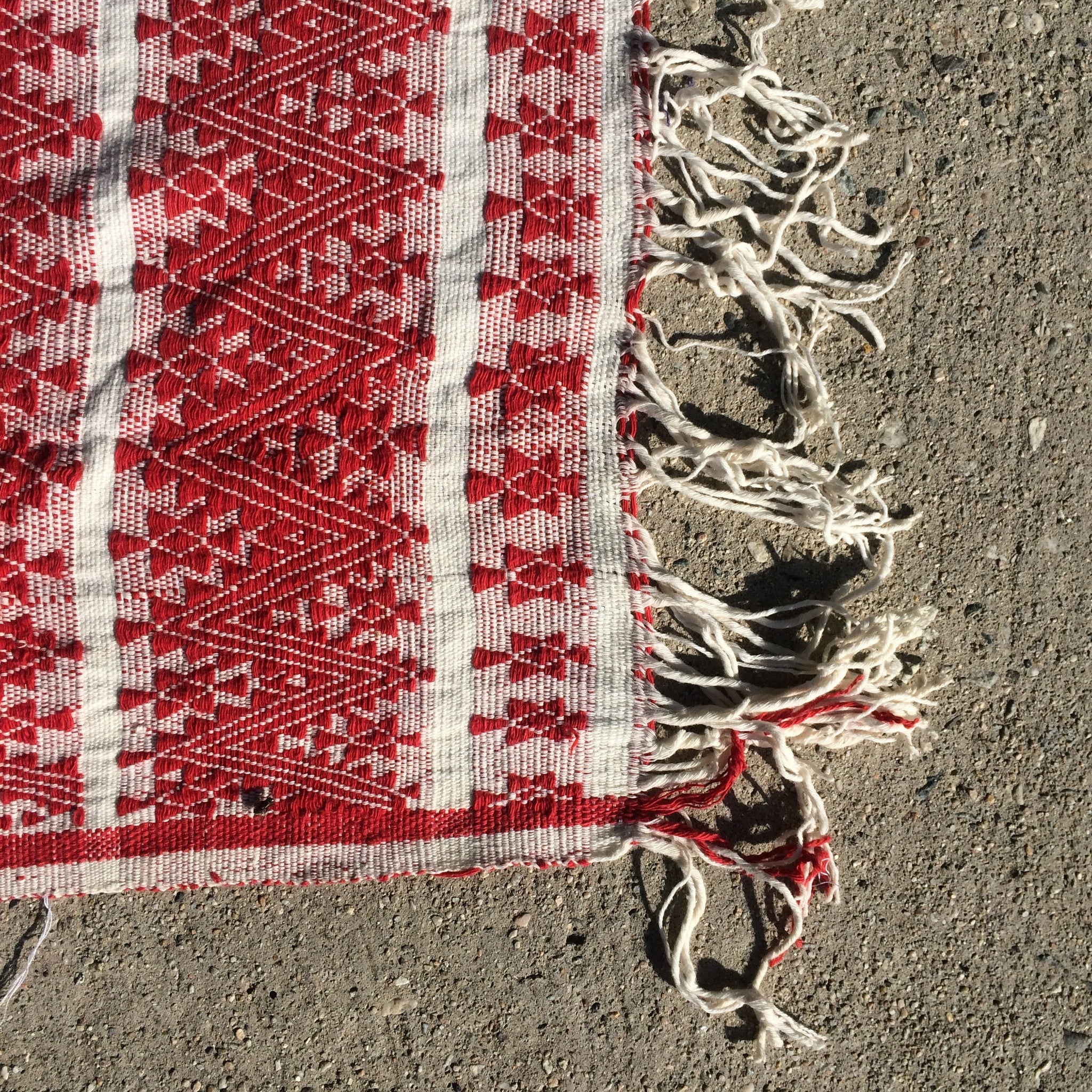 red and cream woven tapestry