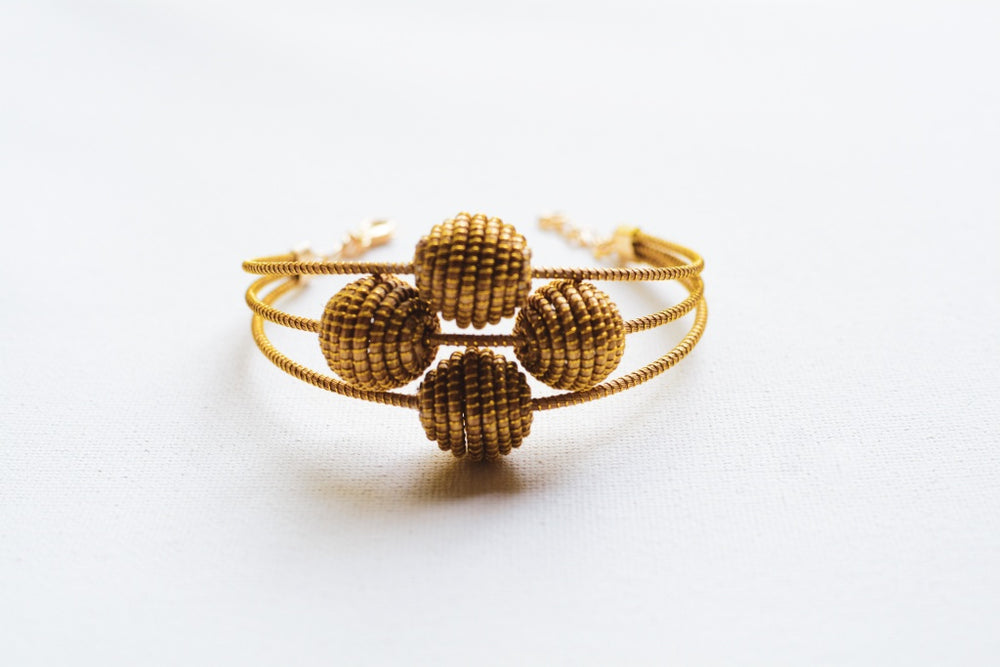 Golden Grass Pom Pom Cuff
