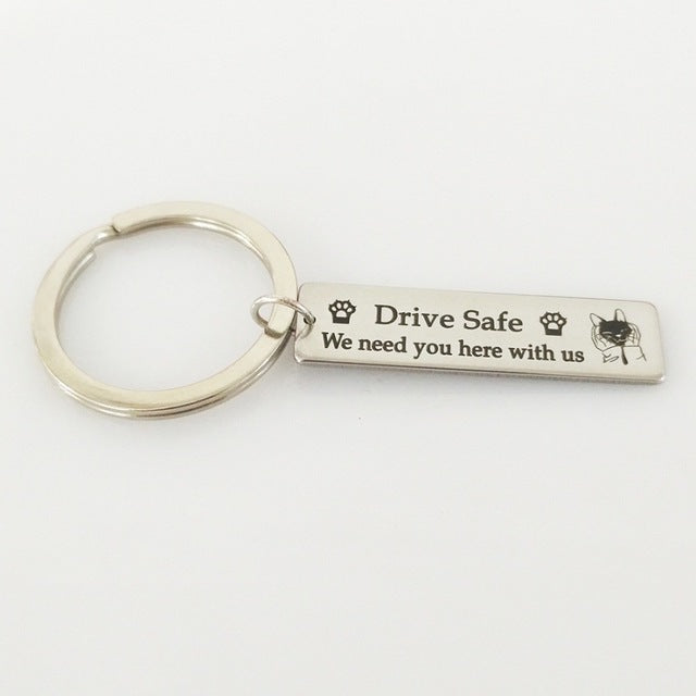 """Drive Safe We Need You Here With Us"" Keychain"