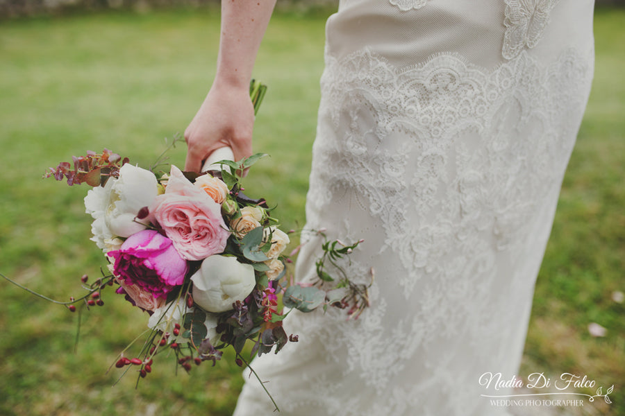 bridal bouquet and wedding dress details