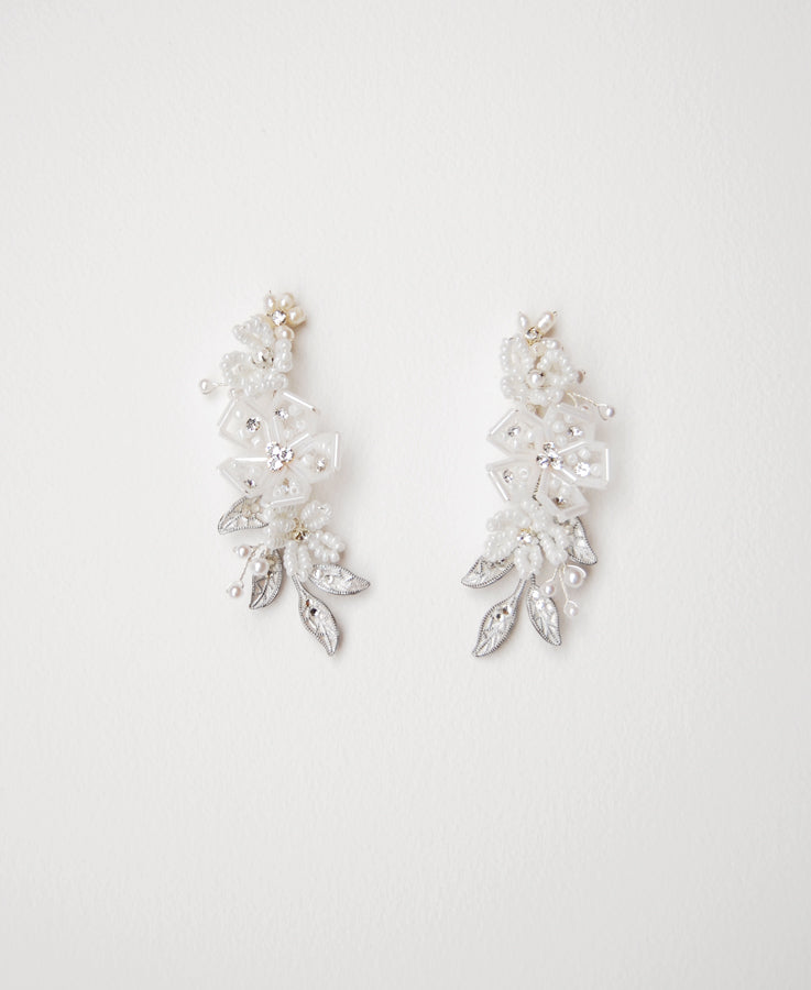 White beaded floral earrings