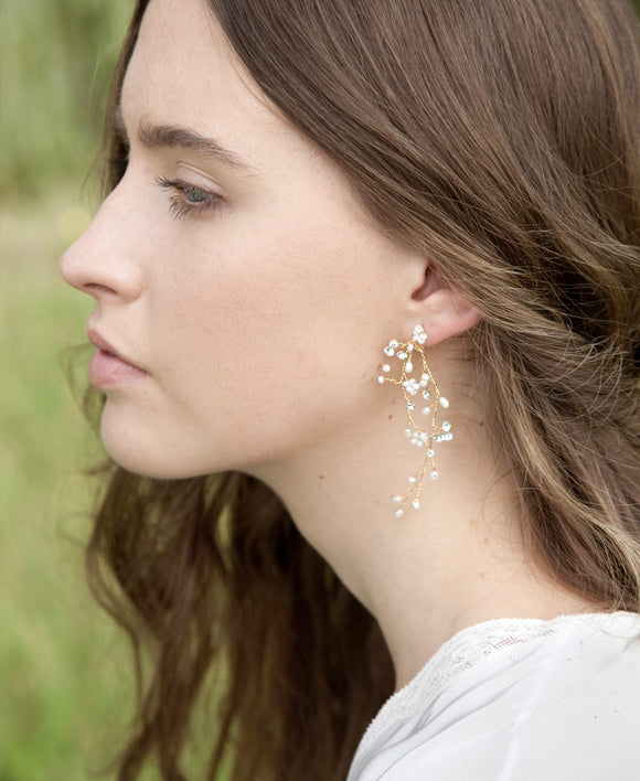 Long vine pearl earrings