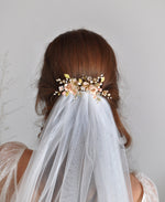 pink floral hair comb with veil