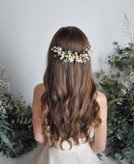 white pink floral hairpiece